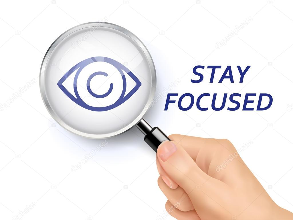stay focused words showing through magnifying glass