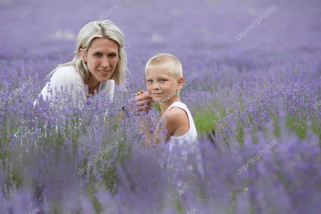 Blonde mother and her son together in lavender field