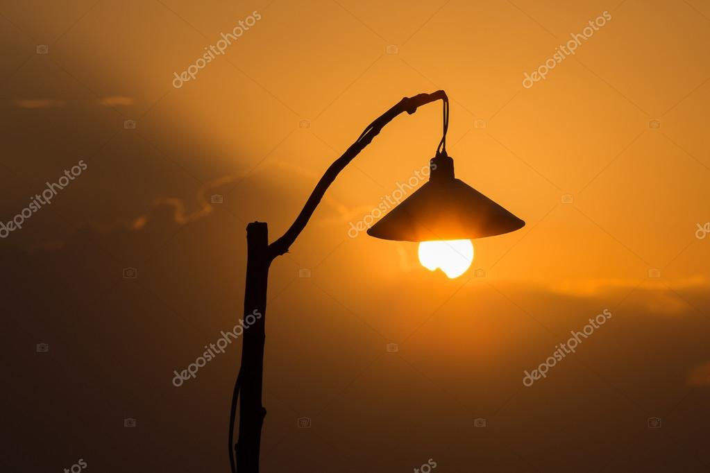 Silhouette Of A Lamp Post At Sunset Stockfoto Olegdoroshenko