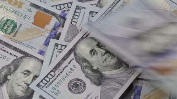 Falling paper money american hundred dollar bills, close up