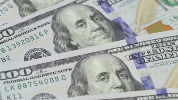 Rotace papíru. Pozadí s penězi americké sta dolarových směnek