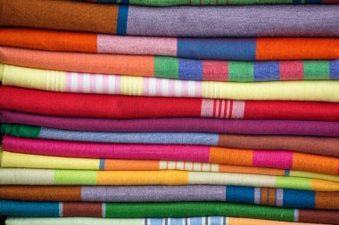 Heap of cloth fabrics at a local market in Sri Lanka. Close up .