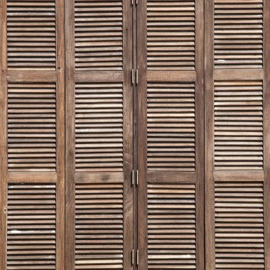 Background latticed wooden doors in the tropical house