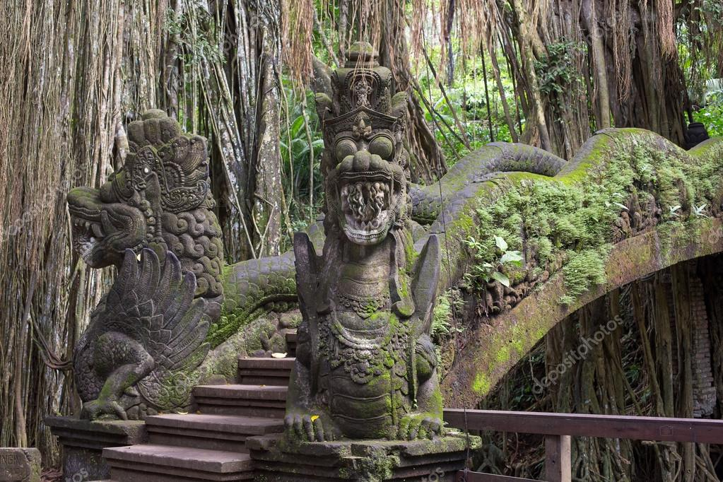Famous dragon bridge in sacred monkey forest in Ubud, Bali, Indonesia.