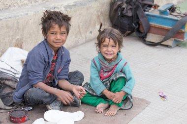 Beggar boy and girl in Leh, India