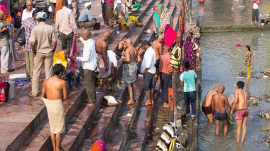 Indian people at ritual washing in the sacred Ganges river. Haridwar , India