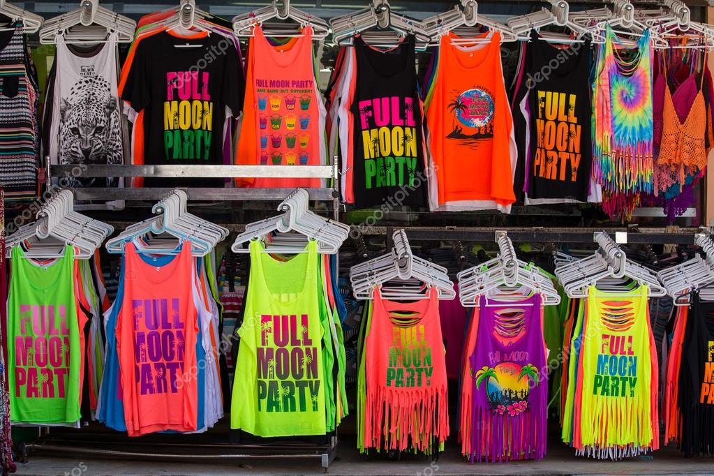 Colorful T-shirts sold on the street shop during the full moon party. Island Koh Phangan, Thailand