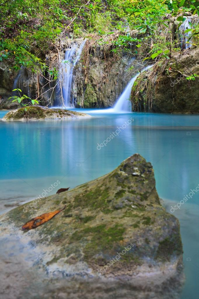 Waterfall and blue stream in the forest