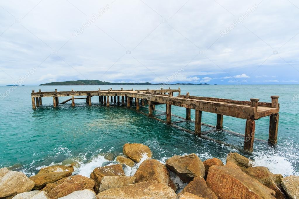 Wooden bridge into the sea