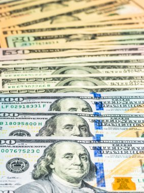 Dollars pile as background