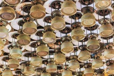 Lit hurricane lamps and lanterns