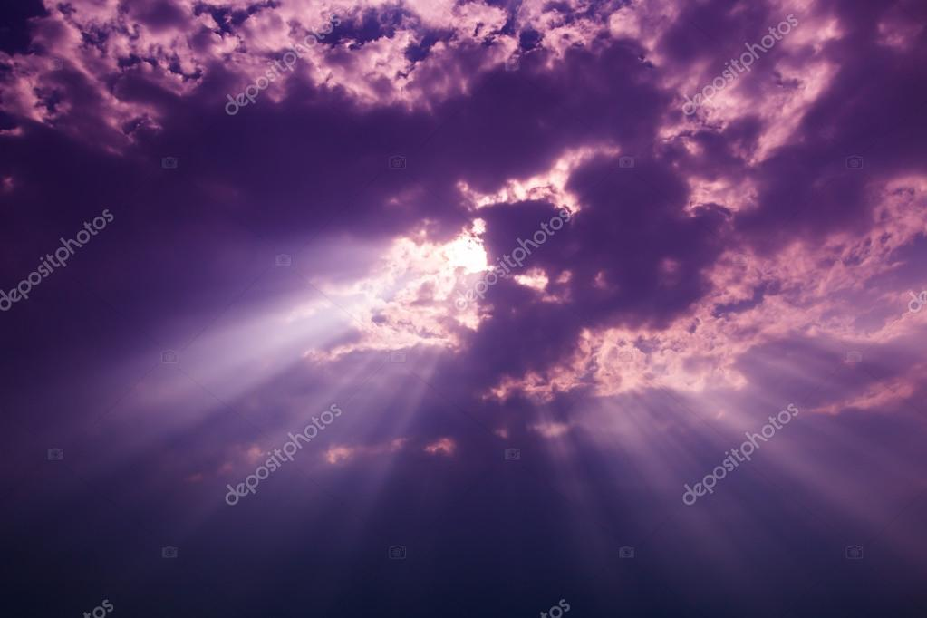 Rays of light shining through dark clouds