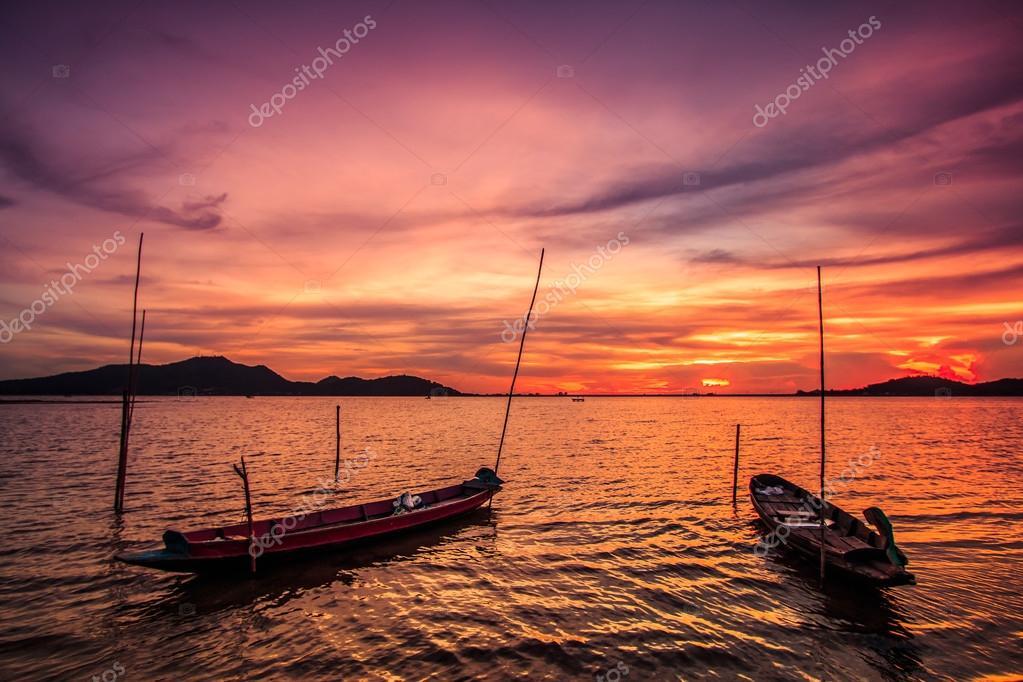 sunset at sea and boats