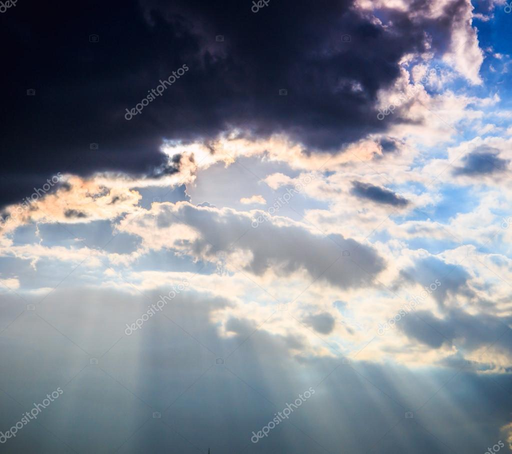 Rays of light shining through clouds