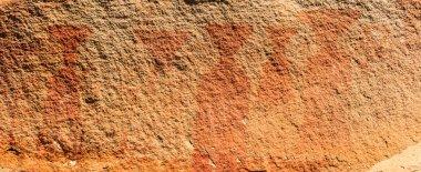 pre-historic art on cave cliff