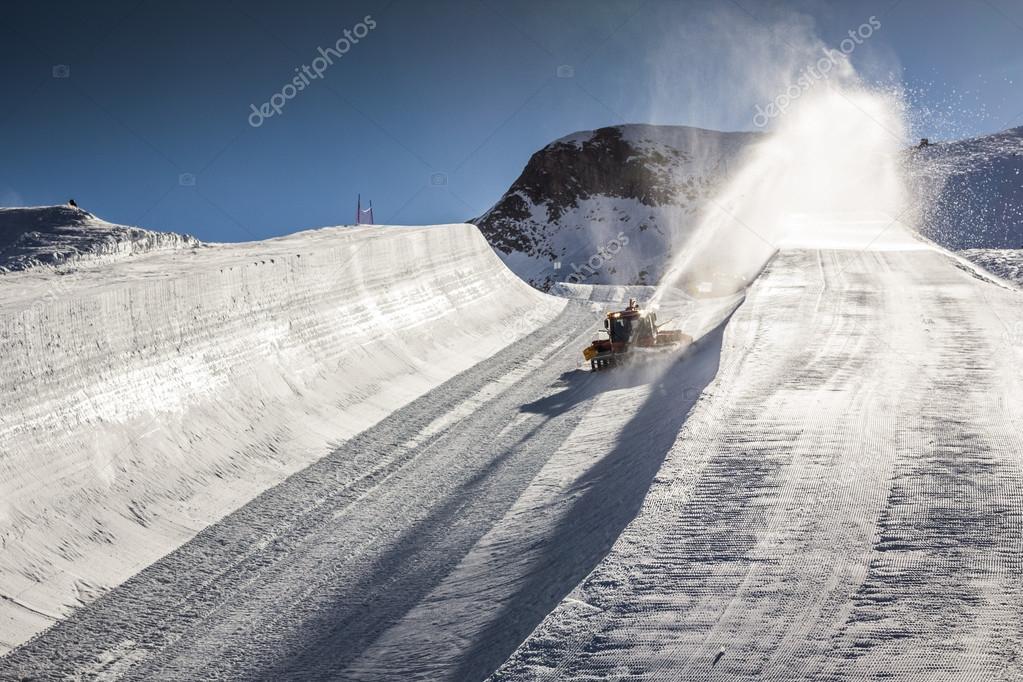 Halfpipe of famous ski resort in Austria with snowcat working