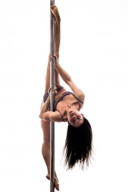 Beautiful young woman exercise pole dance
