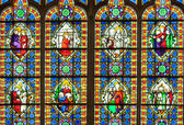 Fotografie Colorful stained glass window with saints.