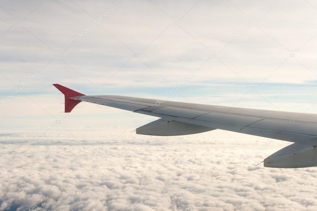 View from the plane on the wing and clouds