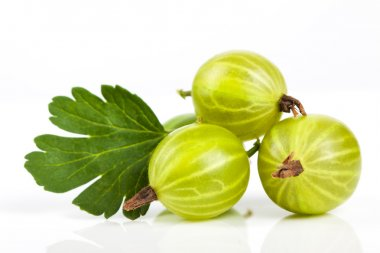 Berries of gooseberry closeup. Ripe juicy sweet berries with green leaf on a white background