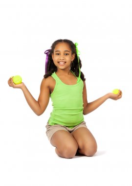 Girl with tennis balls