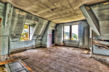Dilapidated attic room in an abandoned manor
