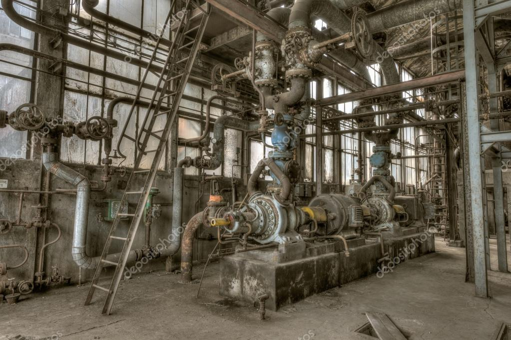 Old and rusty machinery in an abandoned plant — Stock Photo