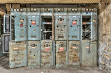 Decayed electrical power cabinets in an abandoned factory
