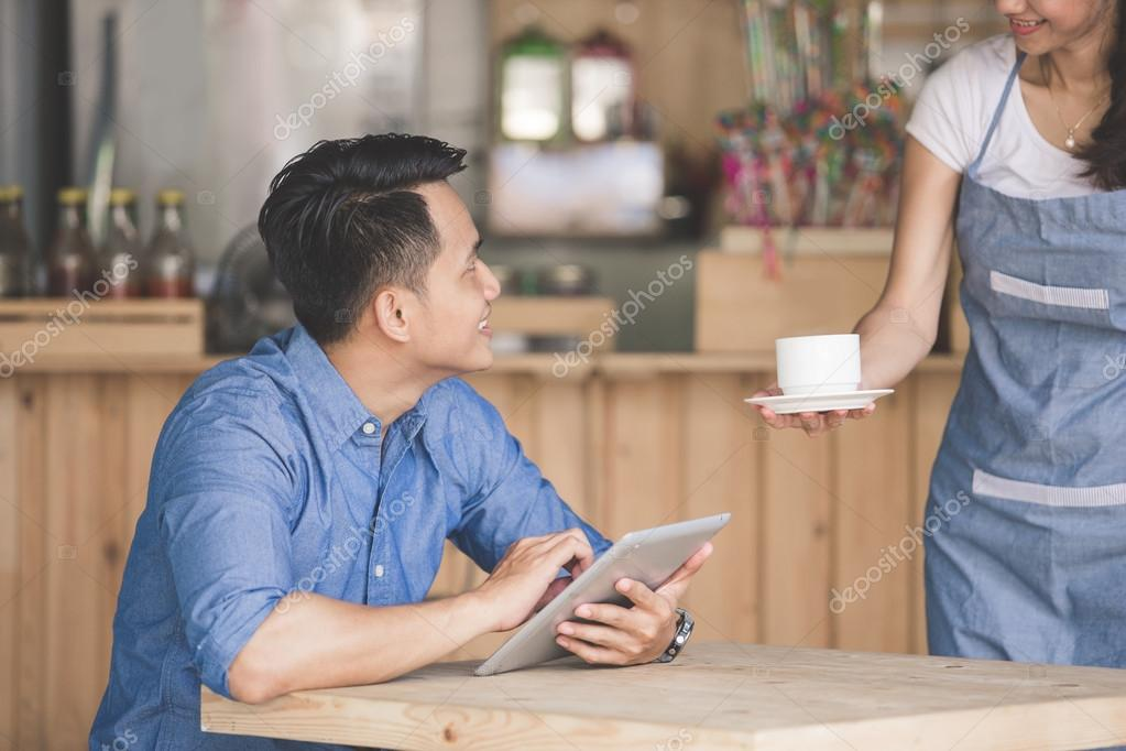 asian woman and man in cafe
