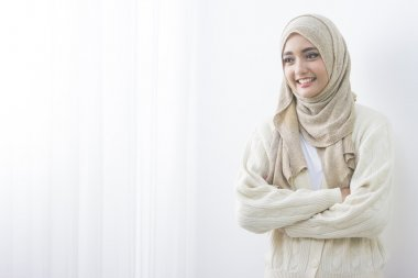 muslim woman in head scarf smile