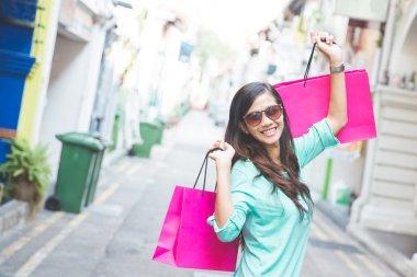asian woman shopping outdoor