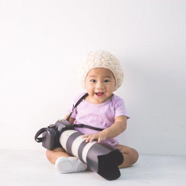 little baby girl sitting on floor
