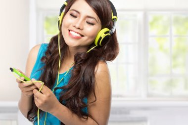 happy Young asian girl with headphones