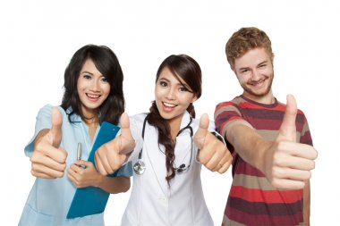 woman doctor with assistant and man patient thumb up