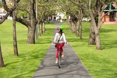 beautiful woman riding a bicycle