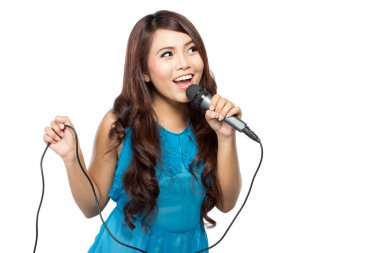 Young woman sing holding a mic, isolated