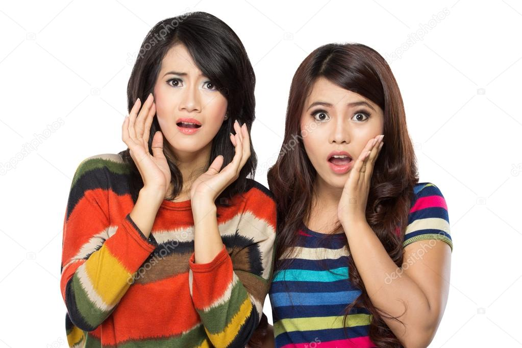 Two young asian woman surprised