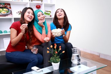 three beautiful women laughing together