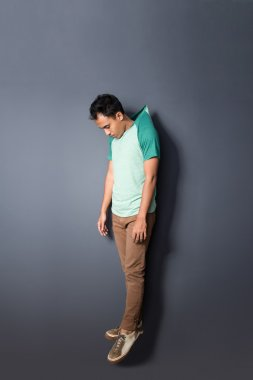 young man floating with his hanged shirt