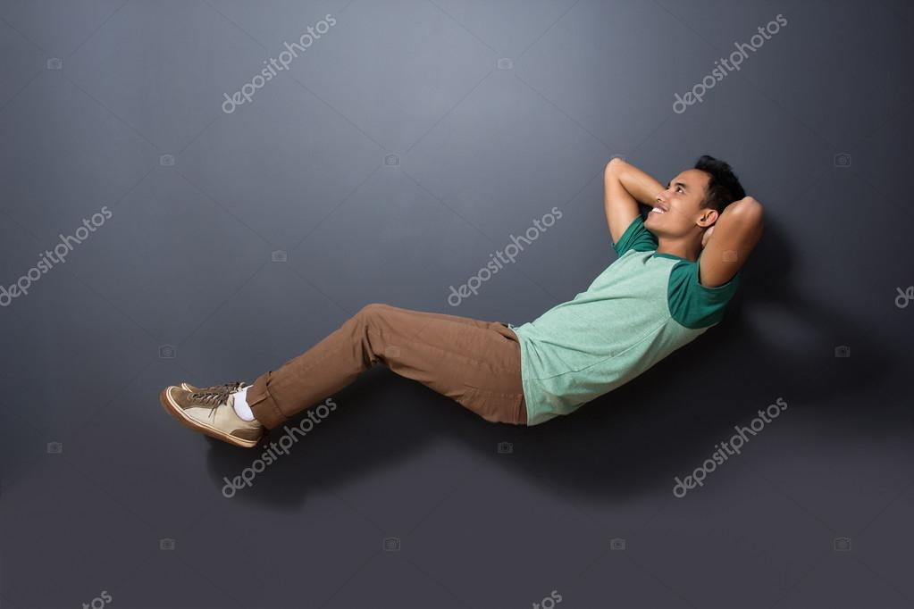 A Handsome Man Floating With Sleeping Pose Stock Photo