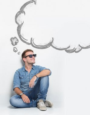 A portrait of young caucasian man wear sunglasses while sitting on the floor thinking about something. copyspace with bubble speech stock vector