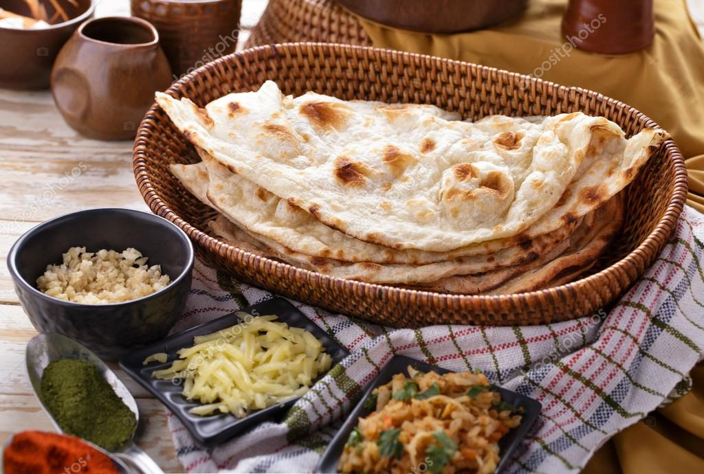 Indian naan bread with some ingredients of indian food