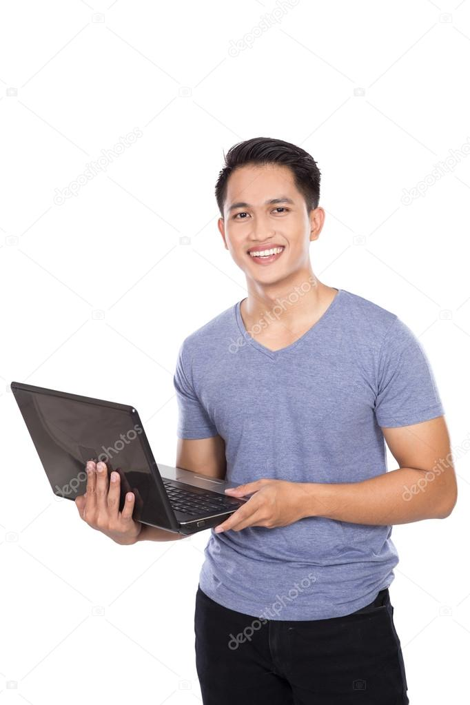 Young asian man standing with a laptop open, isolated