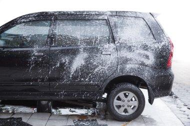 washing a car in a car wash station