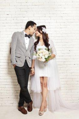 lovely asian newlywed couple