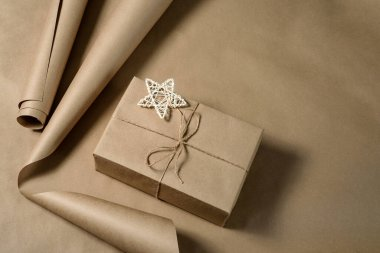 A box wrapped in craft paper and tied with twine. DIY gift decoration.