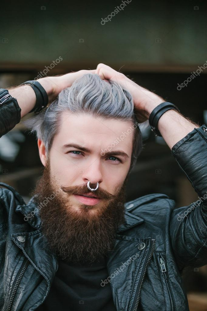 Bearded hipster with nose ring in leather jacket — Stock Photo ...