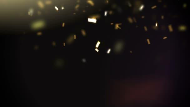 Golden konfety padají