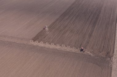 Tractor on harvest field