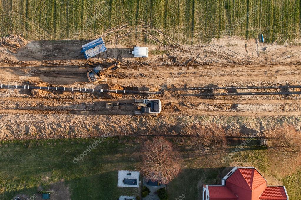 Aerial view of burying gas pipe in a country area